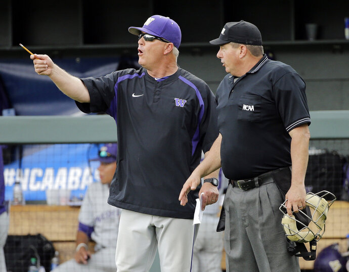 FILE - In this June 3, 2016, file photo, Washington head coach Lindsay Meggs, left, argues a call with home plate umpire David Savage during an NCAA college baseball regional tournament game against UC Santa Barbara in Nashville, Tenn. On Saturday, the Huskies face Mississippi State in the first-round of the College World Series. It's the first trip to Omaha in Washington's history, finally fulfilling the promise of a program that at times has featured great players and great teams, but has never put together a postseason run good enough to find its way to the CWS.  (AP Photo/Mark Humphrey, File)