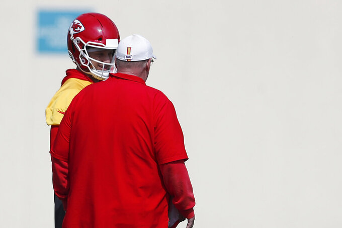 Kansas City Chiefs quarterback Patrick Mahomes (15) talks with head coach Andy Reid during practice on Friday, Jan. 31, 2020, in Davie, Fla., for the NFL Super Bowl 54 football game. (AP Photo/Brynn Anderson)