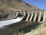 Truckee River water flows through the Derby Dam in Wadsworth, Nev., on Wednesday, Sept. 11, 2019 about 20 miles east of Reno, Nevada where the U.S. Bureau of Reclamation has launched a $23.5 million fish passage project to help the threatened Lahontan cutthroat trout pass upstream to their native spawning grounds cutoff since the dam was built in 1905. The trout, the state fish of Nevada, used to migrate from Pyramid Lake in the high desert 120 miles upstream to spawn in Lake Tahoe. (AP Photo/Scott Sonner).