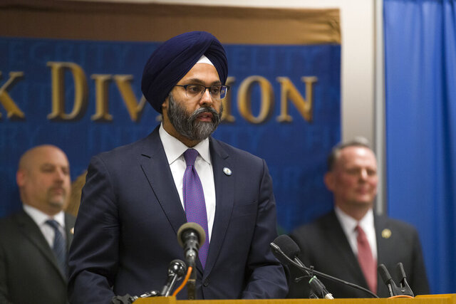 New Jersey Attorney General Gurbir Grewal makes a statement at a new conference to provide an update on the Dec. 10 Jersey City shootings at the FBI headquarters in Newark, N.J., Monday, Jan. 13, 2020. Flanking Grewal are U.S. Attorney Craig Carpentino, left, and FBI Agent in Charge Gregory Ehrie. The two people who fatally shot a police officer then killed three people at a kosher grocery in Jersey City planned an assault for some time and were equipped to cause greater destruction, authorities said Monday. (Steve Hockstein/NJ Advance Media via AP)