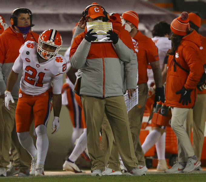 Clemson coach Dabo Swinney watches during the third quarter of the team's NCAA college football game against Virginia Tech on Saturday, Dec. 5, 2020, in Blacksburg, Va. (Matt Gentry/The Roanoke Times via AP, Pool)
