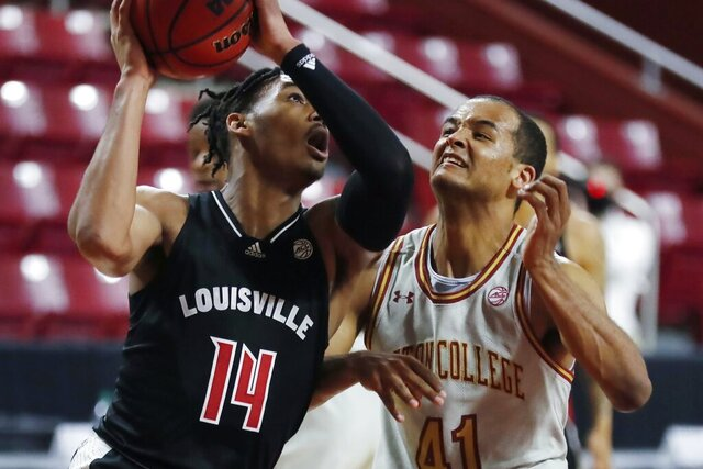 Louisville's Dre Davis (14) shoots against Boston College's Steffon Mitchell (41) during the first half of an NCAA college basketball game, Saturday, Jan. 2, 2021, in Boston. (AP Photo/Michael Dwyer)