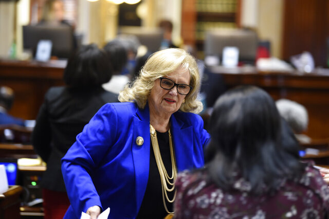 House Rep. Rita Allison, R-Spartanburg, talks with a colleague on the opening day of South Carolina's 2020 legislation on Tuesday, Jan. 14, 2020, in Columbia, S.C. (AP Photo/Meg Kinnard)