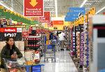 FILE- In this Nov. 9, 2018, file photo shoppers walk through the isles at a Walmart Supercenter in Houston. Walmart Inc. reports earnings Thursday, Nov. 14, 2019. (AP Photo/David J. Phillip, File)