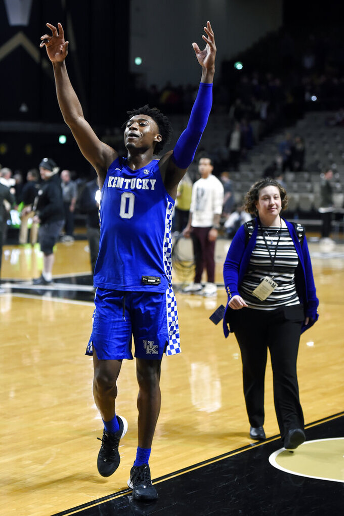 Kentucky guard Ashton Hagans (0) celebrates as he walks off the court after the team's win against Vanderbilt in an NCAA college basketball game Tuesday, Feb. 11, 2020, in Nashville, Tenn. Kentucky won 78-64. (AP Photo/Mark Zaleski)