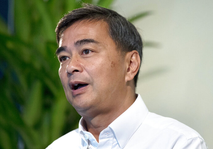 The leader of Thailand's Democrat Party Abhisit Vejjajiva talks to The Associated Press during an interview Wednesday, March 20, 2019. in Bangkok, Thailand. Abhisit says if he becomes prime minister after Sunday's election, he'll make careful but forceful efforts to undo undemocratic constitutional clauses imposed by the military government that took power in 2014. (AP Photo/Sakchai Lalit)
