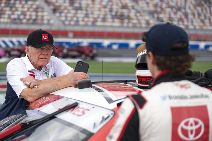 Owner Joe Gibbs and NASCAR Xfinity Series driver Brandon Jones (19) have a conversation on pit road prior to the NASCAR Xfinity auto racing race at the Charlotte Motor Speedway Saturday, Oct. 9, 2021, in Concord, N.C. (AP Photo/Matt Kelley)