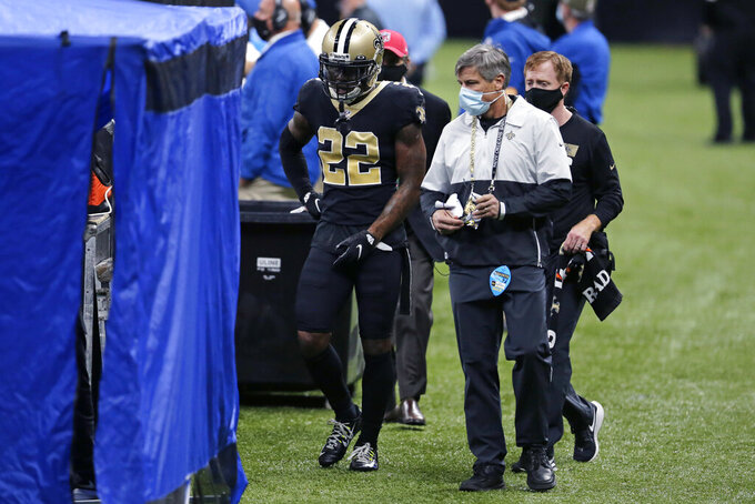 New Orleans Saints safety Chauncey Gardner-Johnson (22) walks to a medical tent on the sideline in the first half of an NFL football game against the Kansas City Chiefs in New Orleans, Sunday, Dec. 20, 2020. (AP Photo/Brett Duke)