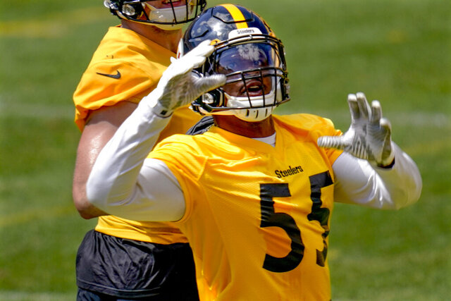 Pittsburgh Steelers linebackers Devin Bush (55) and Robert Spillane participate in a drill during practice at NFL football training camp, Wednesday, Aug. 19, 2020, in Pittsburgh. Bush, the Steelers second-year linebacker, says he believes the NFL game is slowing down for him and that should allow him to play faster after a solid and occasionally spectacular rookie season. (AP Photo/Keith Srakocic)