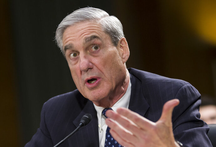 FILE - In this June 19, 2013, file photo, Federal Bureau of Investigation Director Robert Mueller testifies before the Senate Judiciary Committee, on Capitol Hill in Washington. (AP Photo/J. Scott Applewhite, File)