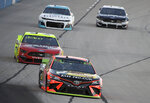 Martin Truex Jr. leads drivers into Turn 1 during practice for the NASCAR Cup Series auto race at Texas Motor Speedway in Forth Worth, Texas, Friday, Nov. 1, 2019. (AP Photo/Larry Papke)