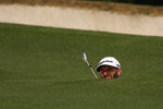 Dustin Johnson prepares to hit on the fifth hole during the first round of the Masters golf tournament on Thursday, April 8, 2021, in Augusta, Ga. (AP Photo/David J. Phillip)