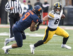 Iowa's Nick Esley (84) runs past Illinois' Dele Harding after making a catch in the first half of a NCAA college football game, Saturday, Nov. 17, 2018, in Champaign, Ill. (AP Photo/Holly Hart)
