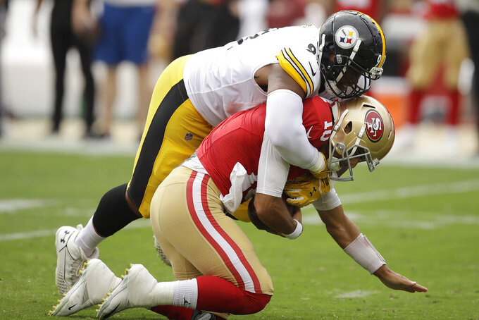 Pittsburgh Steelers defensive end Stephon Tuitt, top, sacks San Francisco 49ers quarterback Jimmy Garoppolo during the first half of an NFL football game in Santa Clara, Calif., Sunday, Sept. 22, 2019. (AP Photo/Ben Margot)