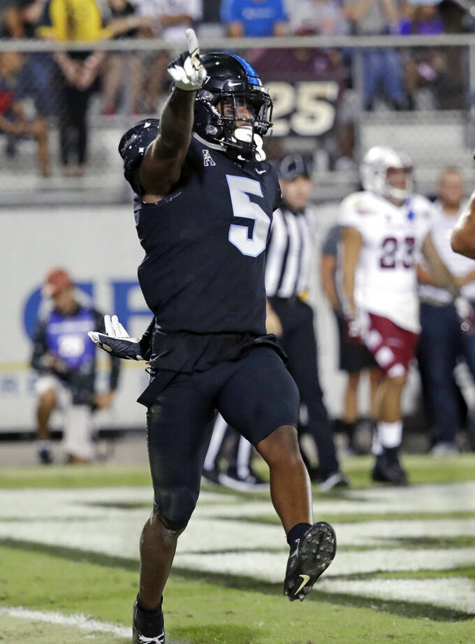 Milton throws 3 TDs, No. 9 UCF holds off Temple 52-40