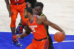 Clemson's John Newman III (15) tries to get past Pittsburgh's Eric Hamilton during the first half of an NCAA college basketball game Wednesday, Feb. 12, 2020, in Pittsburgh. (AP Photo/Keith Srakocic)