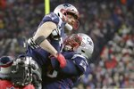 New England Patriots wide receiver Julian Edelman, top, gets a lift from offensive tackle Isaiah Wynn after catching a pass for a two-point conversion in the second half of an NFL football game against the Buffalo Bills, Saturday, Dec. 21, 2019, in Foxborough, Mass. (AP Photo/Elise Amendola)