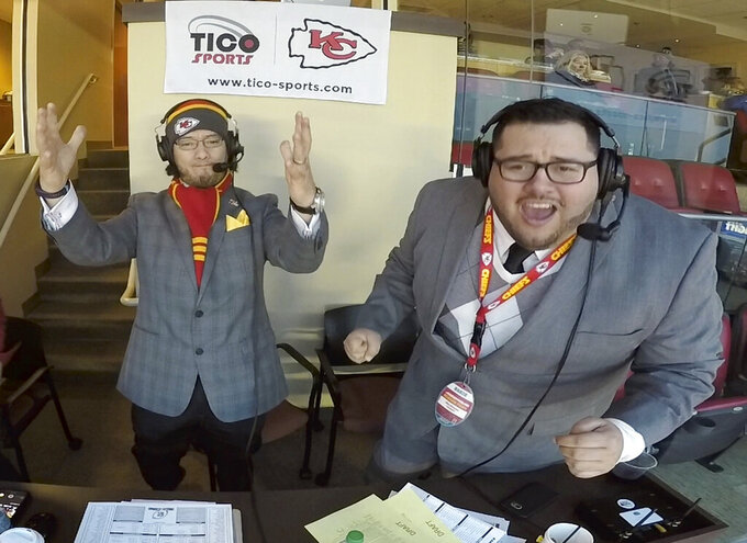 "This Jan. 6, 2018, photo taken from video and provided by Oscar Monterroso, shows Spanish language broadcasters Oscar ""El Tico"" Monterroso, left, and Enrique ""Kike"" Morales working at their broadcast booth inside Arrowhead Stadium in Kansas City, Mo., during the Kansas City Chiefs vs Tennessee Titans NFL wild card game. Monterroso, the color commentator, and Morales, the play-by-play man, have been calling Chiefs games in Spanish since 2011, and will broadcast on Saturday, Oct. 5, 2019, Nebraska's NCAA college football game against Northwestern. Nebraska will be the first school in the Big Ten to offer a Spanish-language radio broadcast for a football game. (Oscar Monterroso/Tico Productions via AP)"