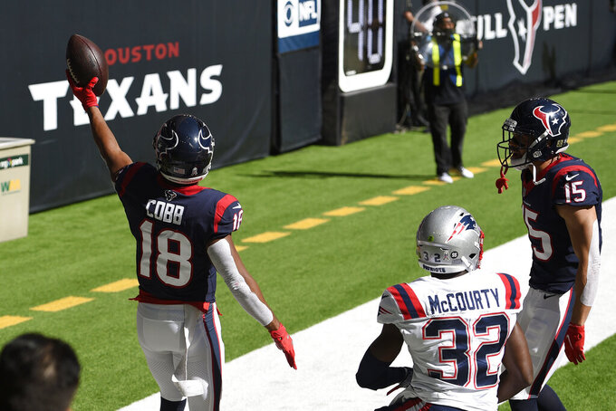 Houston Texans wide receiver Randall Cobb (18) celebrates his touchdown catch in front of New England Patriots free safety Devin McCourty (32) during the first half of an NFL football game, Sunday, Nov. 22, 2020, in Houston. (AP Photo/Eric Christian Smith)