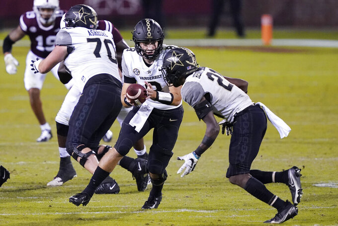 Vanderbilt running back Keyon Henry-Brooks (21) takes a handoff from quarterback Ken Seals (8) on his way to a 27-yard touchdown run against Mississippi State during the second half of an NCAA college football game in Starkville, Miss., Saturday, Nov. 7, 2020. (AP Photo/Rogelio V. Solis)