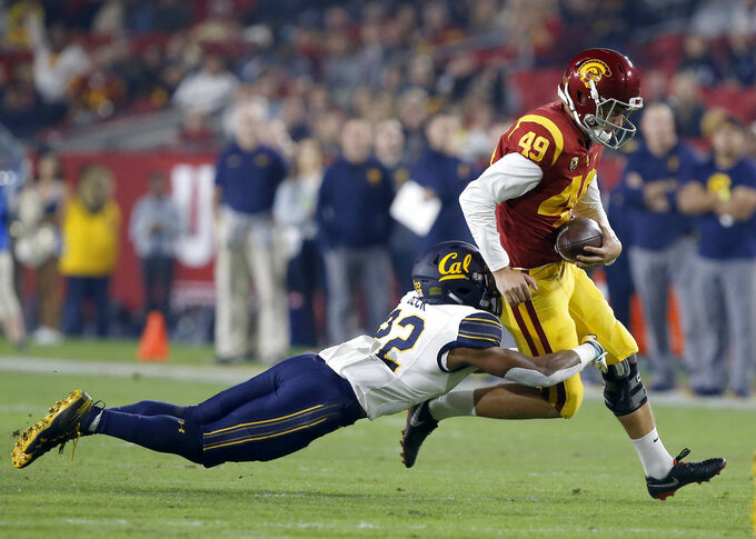 Southern California kicker Michael Brown, right, is pulled down by California' Traveon Beck, left, on a fake field goal during the first half of an NCAA college football game in Los Angeles, Saturday, Nov. 10, 2018. (AP Photo/Alex Gallardo)