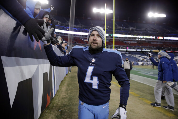 FILE — In this Dec. 31, 2017, file photo, Tennessee Titans kicker Ryan Succop shakes hands with fans after defeating the Jacksonville Jaguars in an NFL football game in Nashville, Tenn. The Titans have waived three-time Pro Bowl tight end Delanie Walker and kicker Ryan Succop. Injuries ended each of Walker's last two seasons.  Succop made only one field goal last season. The Titans announced the moves Friday, March 13, 2020 a day after waiving linebacker Cameron Wake and Dion Lewis. (AP Photo/James Kenney, File)