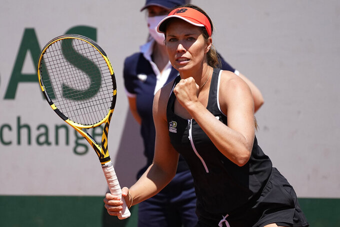 United States' Danielle Collins clenches her fist after winning a point as she plays China's Xiyu Wang during their first round match of the French Open tennis tournament at the Roland Garros stadium Sunday, May 30, 2021 in Paris. (AP Photo/Michel Euler)