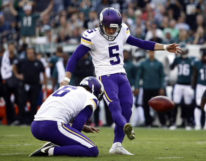 FILE - In this Oct. 7, 2018, file photo, Minnesota Vikings' Dan Bailey (5) kicks a field goal during the first half of an NFL football game against the Philadelphia Eagles in Philadelphia. The Vikings have agreed to terms on a new contract with Bailey, the ninth-year veteran who was signed last season to replace struggling rookie Daniel Carlson.  (AP Photo/Matt Rourke, File)