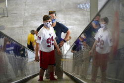 Fans arrive for an NFL football game between the Houston Texans and the Minnesota Vikings, Sunday, Oct. 4, 2020, in Houston. (AP Photo/David J. Phillip)