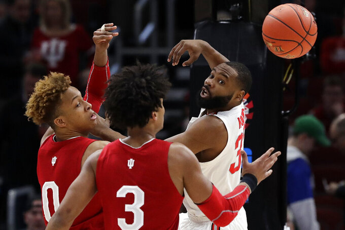Ohio State's Keyshawn Woods (32) passes the ball against Indiana's Romeo Langford (0) and Justin Smith (3) during the first half of an NCAA college basketball game in the second round of the Big Ten Conference tournament, Thursday, March 14, 2019, in Chicago. (AP Photo/Nam Y. Huh)