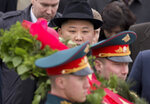 North Korean leader Kim Jong Un, center, attends a wreath laying ceremony in Vladivostok, Russia, Friday, April 26, 2019. Kim paid his respects at a ceremony honoring the war dead Friday to wrap up a brief and generally successful visit to the Russian Far East for his first summit with President Vladimir Putin. (AP Photo/Alexander Khitrov)