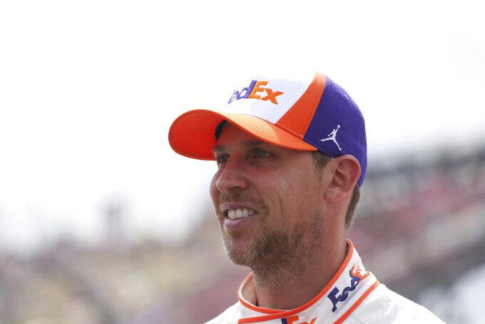 Denny Hamlin before a NASCAR Cup Series auto race in Watkins Glen, N.Y., on Sunday, Aug. 8, 2021. (AP Photo/Joshua Bessex)