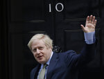Britain's Prime Minister Boris Johnson returns to 10 Downing Street after meeting with Queen Elizabeth II at Buckingham Palace, London, on Friday, Dec. 13, 2019. Prime Minister Boris Johnson's Conservative Party has won a solid majority of seats in Britain's Parliament — a decisive outcome to a Brexit-dominated election that should allow Johnson to fulfil his plan to take the U.K. out of the European Union next month. (AP Photo/Matt Dunham)