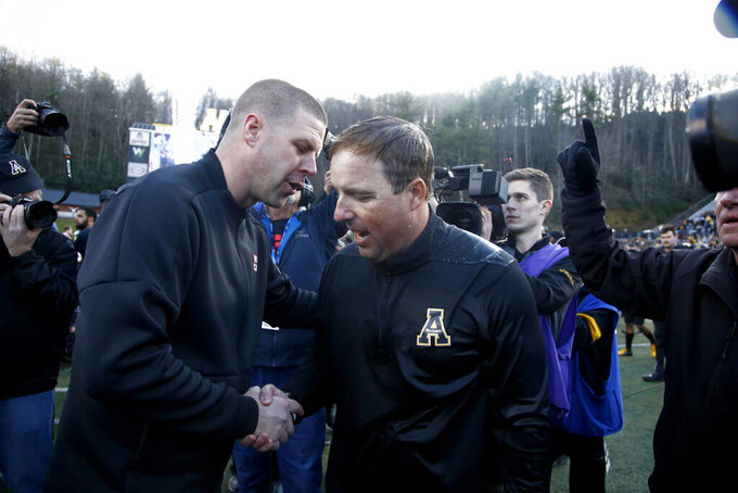 Louisiana-Lafayette head coach Billy Napier, left, and Appalachian State head coach Eliah Drinkwitz meet on the field following Appalachian State's 45-38 win in an NCAA college football game for the Sun Belt Football Championship on Saturday, Dec. 7, 2019, in Boone, N.C. (AP Photo/Brian Blanco)