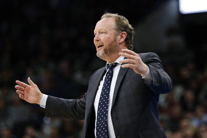 FILE - In this Jan. 6, 2020, file photo, Milwaukee Bucks head coach Mike Budenholzer reacts to a call during the first half of an NBA basketball game against the San Antonio Spurs in San Antonio. The NBA-leading Bucks remain confident the pandemic won't put a permanent halt to the season and that they'll get to resume chasing their first league title in nearly half a century. The Bucks owned a 53-12 record when play was suspended on March 11. (AP Photo/Eric Gay, File)