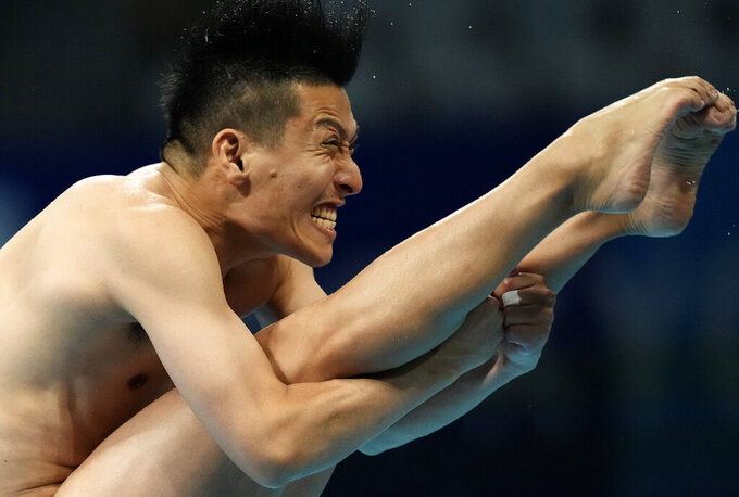 Ken Terauchi of Japan competes in men's diving 3m springboard final at the Tokyo Aquatics Centre at the 2020 Summer Olympics, Tuesday, Aug. 3, 2021, in Tokyo, Japan. (AP Photo/Dmitri Lovetsky)