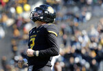 Missouri quarterback Drew Lock reacts after throwing an incomplete pass during the first half of an NCAA college football game against Vanderbilt, Saturday, Nov. 10, 2018, in Columbia, Mo. (AP Photo/Jeff Roberson)