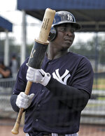 New York Yankees' Didi Gregorius waits in the on-deck circle during a Gulf Coast League baseball game Monday, May 20, 2019, in Tampa, Fla. Gregorius is playing for the first time since having Tommy John surgery. (AP Photo/Chris O'Meara)