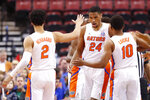 Florida guards Andrew Nembhard (2) and Noah Locke (10) congratulate forward Kerry Blackshear Jr. (24) after a shot in the first half of an NCAA college basketball game against Utah State, part of the Orange Bowl Classic tournament, Saturday, Dec. 21, 2019, in Sunrise, Fla. (AP Photo/Wilfredo Lee)