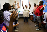 In this Thursday, June 27, 2019 photo, Jocelyn Stovall, of Evolve Music Therapy, dances with special needs students in Montgomery, Ala. (Jake Crandall/Montgomery Advertiser via AP)
