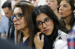 Israeli backpacker Naama Issachar's mother Yaffa Issachar, left, and sister Liad Goldberg wait to Issachar's appeal hearings in a courtroom in Moscow, Russia, Thursday, Dec. 19, 2019. Naama was sentenced in October to seven and a half years in prison for drug smuggling after authorities in April found nine grams of marijuana in her luggage. (AP Photo/Alexander Zemlianichenko Jr.)