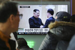 People watch a TV screen showing North Korean leader Kim Jong Un, left, meeting with South Korean National Security Director Chung Eui-yong in Pyongyang, North Korea, at the Seoul Railway Station in Seoul, South Korea, Wednesday, March 7, 2018. After years of refusal, North Korean leader Kim Jong Un is willing to discuss the fate of his atomic arsenal with the United States and has expressed a readiness to suspend nuclear and missile tests during such talks, a senior South Korean official said Tuesday. Korean characters seen on the screen read: