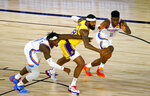 Los Angeles Lakers' Markieff Morris, center, battles for the ball with Oklahoma City Thunder's Luguentz Dort (5) and Hamidou Diallo (6) during the first half of an NBA basketball game Wednesday, Aug. 5, 2020, in Lake Buena Vista, Fla. (Kevin C. Cox/Pool Photo via AP)