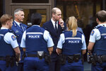 Britain's Prince William, center, meets with first responders during a visit to the Justice and Emergency Services Precinct in Christchurch, New Zealand, Thursday, April 25, 2019. Prince William is on a two-day visit to New Zealand to take part in ANZAC ceremonies and visit the two mosques where a gunman killed 50 people on March 15. (Marty Melville/Pool Photo via AP)