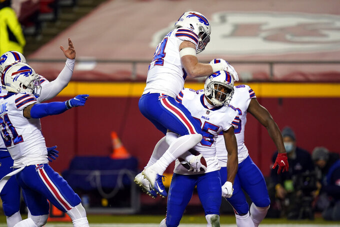 Buffalo Bills running back Taiwan Jones, right, celebrates with teammates after recovering a fumble during the first half of the AFC championship NFL football game against the Kansas City Chiefs, Sunday, Jan. 24, 2021, in Kansas City, Mo. (AP Photo/Orlin Wagner)
