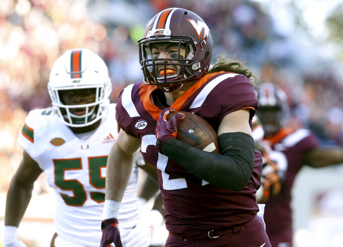 Virginia Tech's Dalton Keene (29) scores on a 15 yard touchdown pass from quarterback Bryce Watts (5) in the first half of an NCAA college football game against Miami in Blacksburg, Va., Saturday, Nov. 17 2018. (Matt Gentry/The Roanoke Times via AP)