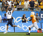 West Virginia's David Sills (13) catches a touchdown pass past Tennessee's Trevon Flowers (25) in the second half of an NCAA college football game in Charlotte, N.C., Saturday, Sept. 1, 2018. (AP Photo/Chuck Burton)