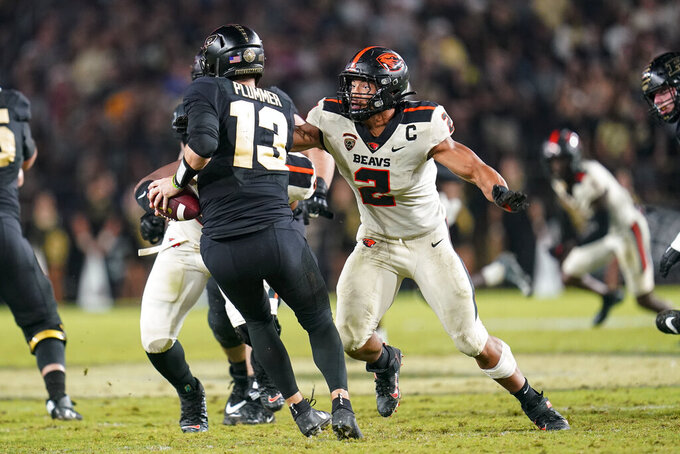 Oregon State linebacker Andrzej Hughes-Murray (2) sacks Purdue quarterback Jack Plummer (13) during the second half of an NCAA college football game in West Lafayette, Ind., Saturday, Sept. 4, 2021. (AP Photo/Michael Conroy)