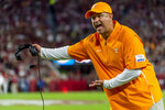 FILE - In this Oct. 19, 2019, file photo, Tennessee head coach Jeremy Pruitt argues a call during the first half of an NCAA college football game against Alabama, in Tuscaloosa, Ala. No. 16 Tennessee has given coach Jeremy Pruitt a raise and a contract extension through 2025 after two seasons on the job.  Tennessee announced the extension Thursday, Sept. 24, 2020, that will hike Pruitt's pay from $3.8 million this season to $4.2 million in 2021. (AP Photo/Vasha Hunt, File)