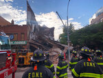 Firefighters work the scene of a building collapse in the Brooklyn borough of New York, Wednesday, July 1, 2020. The multistory health club shuttered by the coronavirus pandemic collapsed into a heap of rubble on street Wednesday, three weeks after building inspectors ordered a halt to some construction work at the location because of structural problems. (AP Photo/Wong May-E)
